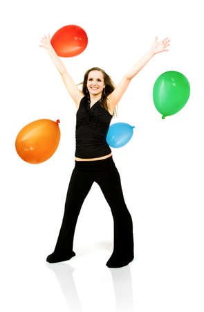 Beautiful young woman celebrates with balloons