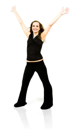 Beautiful young woman celebrates against a white background