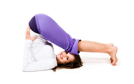 Beautiful young woman exercising - isolated on white Stock Photo