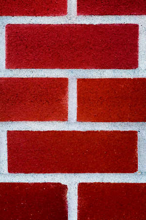 Closeup of a colorful red brick surface Stock Photo