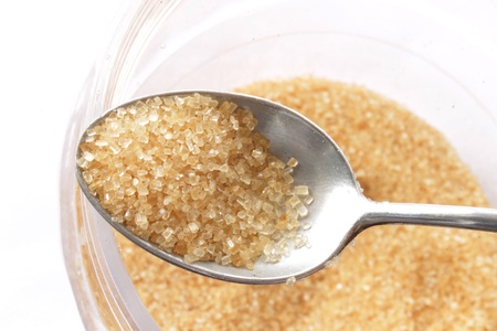 fructose: granulated sugar in a spoon