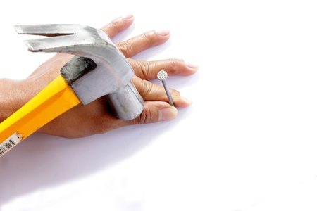 accident at work: Hammer and nail  Stock Photo