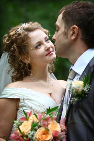 Bride looking in groom