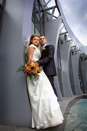 bridal couple: Bride and groom near collonnade Stock Photo