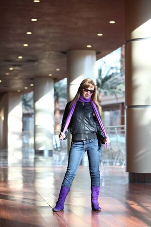 life jackets: Young fashioned woman in violet boots and scarf