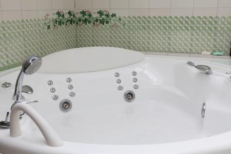Modern style of bath with gydro massage photo