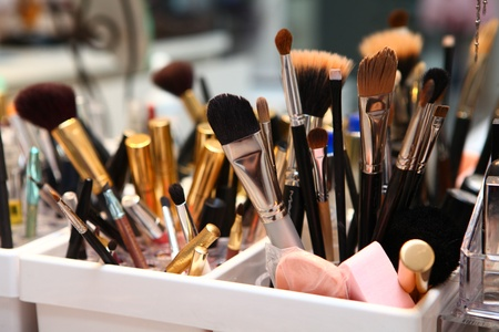 make up brush: Toilette table with boxes with cosmetic brushes