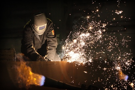 ironwork: The welder working with  the metal construction