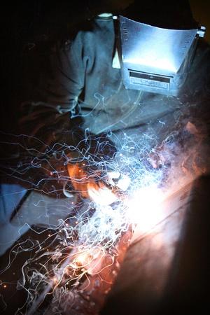 Welder working with metal construction