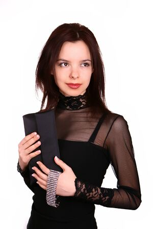 Young lady in black dress with handbag photo