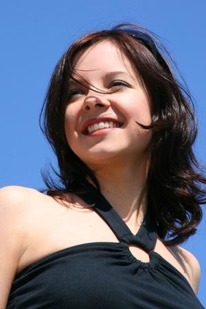Smiling young beautiful woman Stock Photo