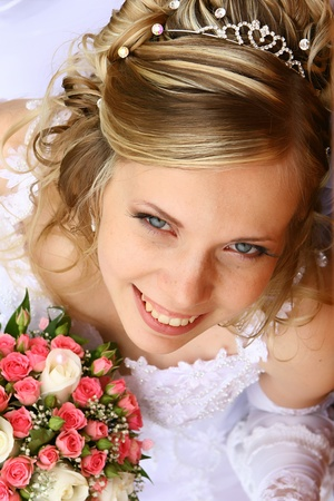 Bride with a wedding bouquet photo