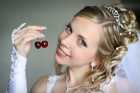 bridal hair: Beautiful bride with sweet cherry Stock Photo