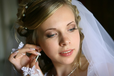 Portraint of a young beautiful bride wearing earring