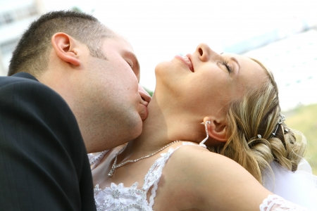 Kiss of bride and groom photo