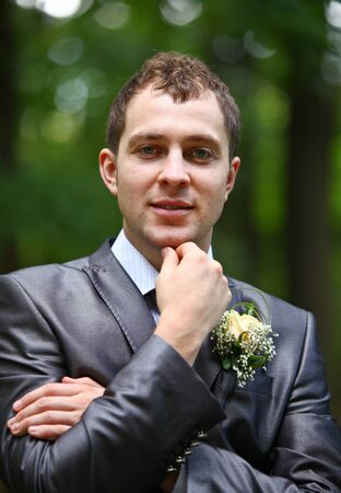 Groom in the grey suit and scarf