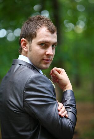 Groom in the grey suit and scarf photo