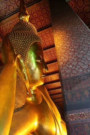 The reclining Buddha at Wat Pho in Bangkok, Thailand  Largest reclining Buddha in the world   photo