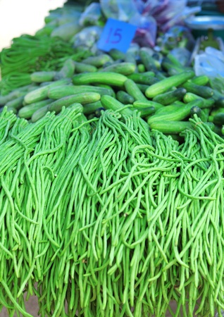 large bean: Green beans and cucumbers on Phuket market, Thailand