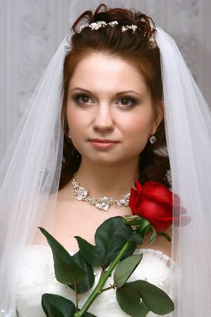 ceremonial: Bride in vail with red rose
