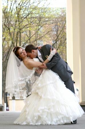 Wedding couple walking near theatre columns Stock Photo