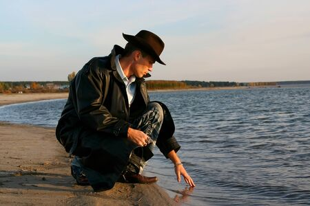 Man touching water in the lake Stock Photo - 13510061