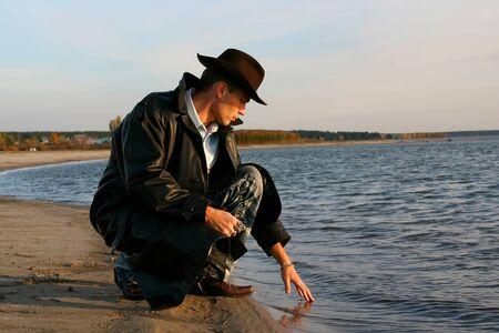 Man touching water in the lake photo