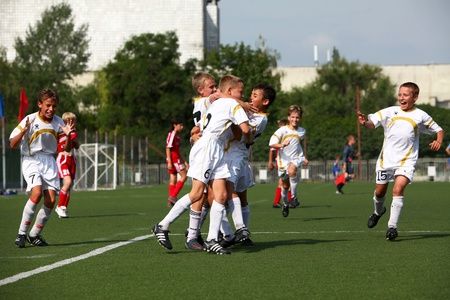 BELGOROD, RUSSIA - AUGUST 04  Unidentified boys embraces after goal on August, 04 2010 in Belgorod, Russia  The final of Chernozemje superiority, Football kinder team of 1996 year of birth