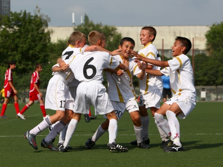 BELGOROD, RUSSIA - AUGUST 04  Unidentified boys embraces after goal on August, 04 2010 in Belgorod, Russia  The final of Chernozemje superiority, Football kinder team of 1996 year of birth   Stock Photo - 13538075