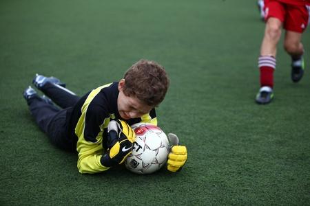 BELGOROD, RUSSIA - JULY 4  Unidentified boy plays football as goalkeeper July, 4 2010 in Belgorod, Russia  The final of Chernozemje superiority, Football kinder team of 1998 year of birth