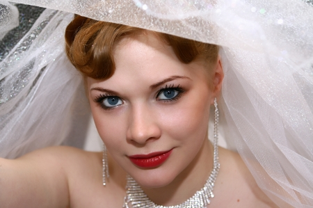 Young beautiful bride with red hair photo