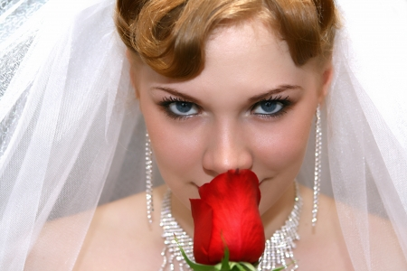 Beautiful bride with red rose