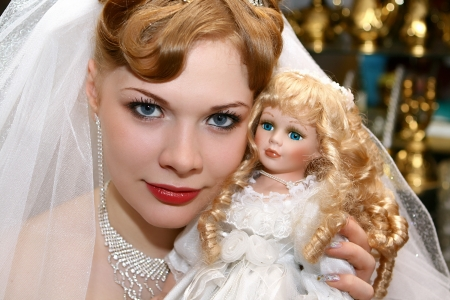 Red haired bride with the same doll Stock Photo - 13682390