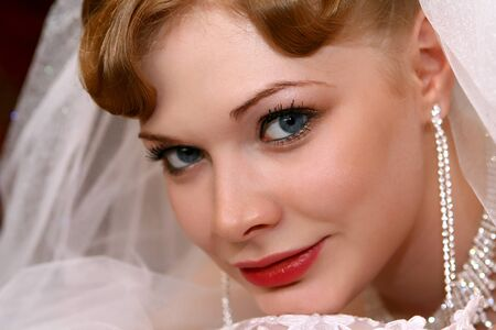 ceremonial make up: Young beautiful bride with red hair Stock Photo