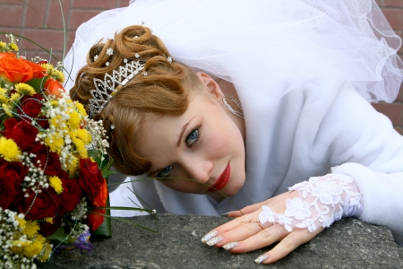 Bride looking up with a bouquet photo