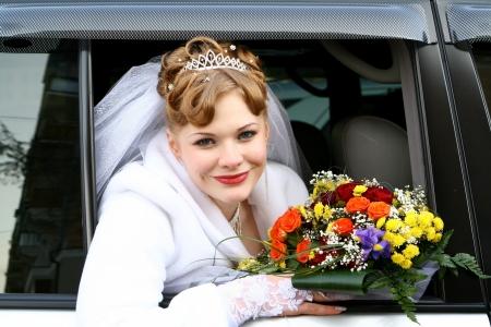 Bride in the car window photo