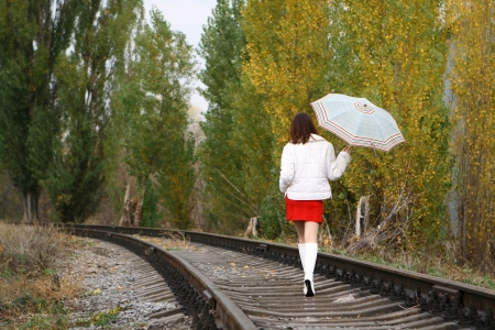 Young woman in white leaving on the railway Stock Photo - 13666307