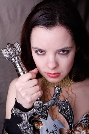Gothic woman with wet face and sword photo