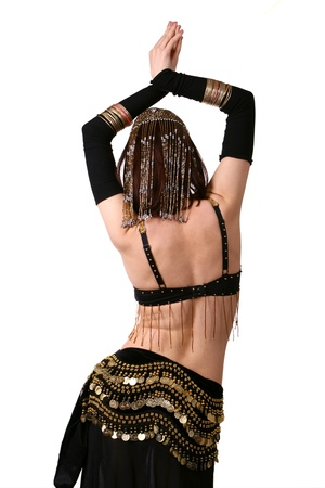 Back of belly dancer on white background photo