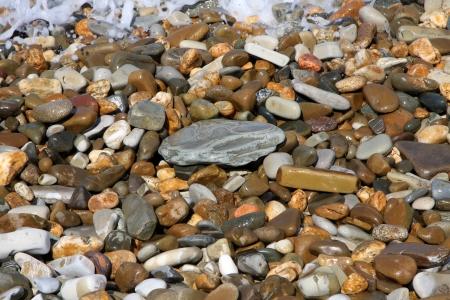 Wet stones on the sun in summer photo