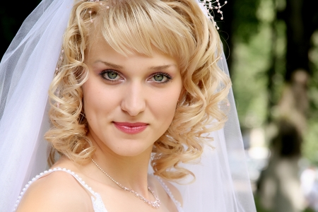 Young beautiful bride with blond hair photo