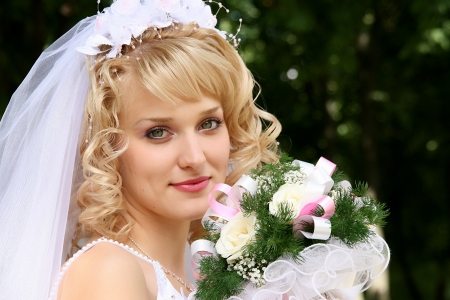 bridal veil: Young beautiful bride with blond hair