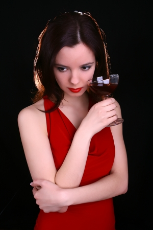 Woman in red with wine