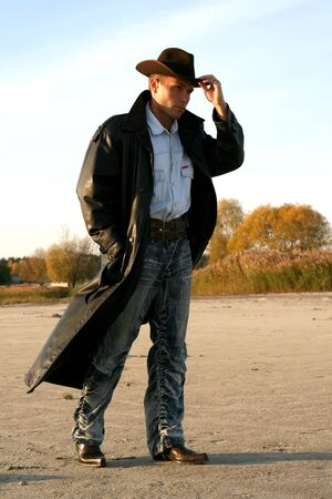 Man in coat on the wind Stock Photo - 14509773