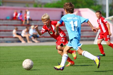 voronezh: BELGOROD, RUSSIA - JUNE 15  Unidentified player from football team  Football Academy   Voronezh  attacking on June 15, 2012 in Belgorod, Russia  Chernozemie Superiority  Team of 2001 year of birth  Editorial