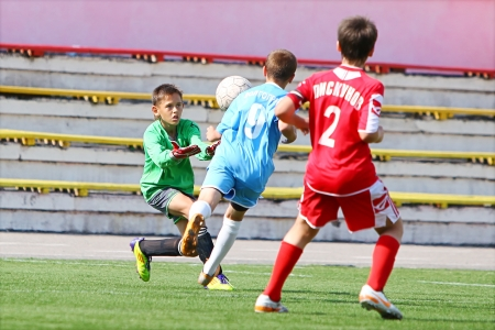 BELGOROD,RUSSIA - JUNE 15  Unidentified goalkeeper from football team  Football Academy  Voronezh  catching ball on June 15,2012 in Belgorod,Russia Chernozemie Superiority Team of 2001 year of birth