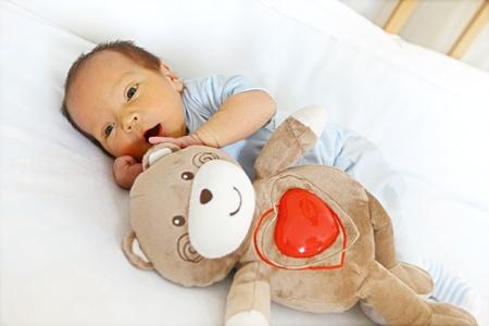 Newborn with bear toy Stock Photo