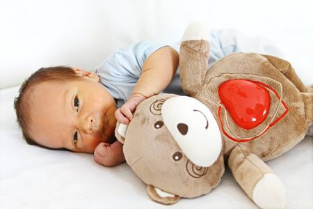 Newborn with bear toy photo