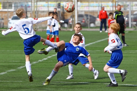 BELGOROD, RUSSIA - APRIL 28  Unidentified boys plays football on April, 28 2013 in Belgorod, Russia  Chernozemje superiority, Football kinder team  Kursk  and  Rossosh  of 2003 year of birth