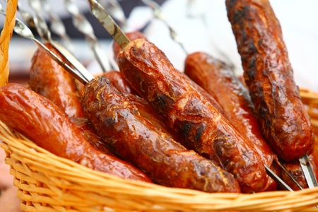 Roast sausages in the basket on picnic